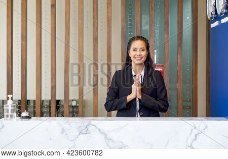 The Hotel Receptionist With A Smile,  Raise Her Hand To Pay Respect In Thai Culture. A Silver Servic