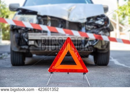 Red Emergency Stop Triangle Sign And Red Warning Police Tape Afore Destroyed Car In Car Crash Traffi