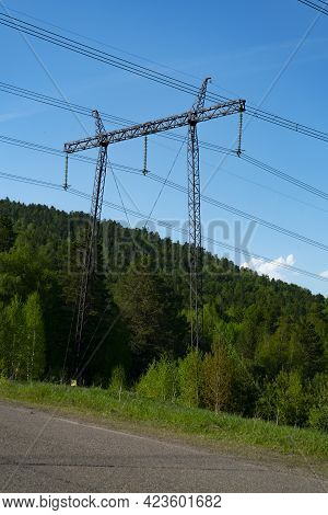 Large Massive Metal Electric Pole On Four Supports.
