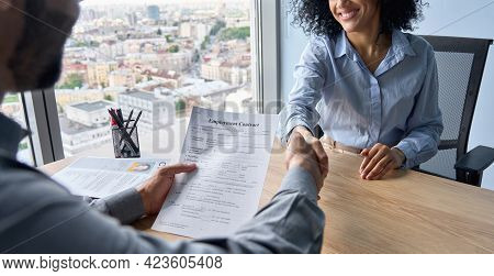 Closeup Of Indian Latin Ceo Holding Employment Contract Job Offer Hiring Welcoming Female African Am