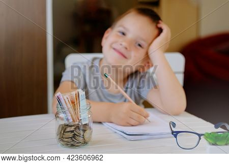 Kid Save Money And Dreaming About New Toys, Making A Wish List, Account Banking For Finance Concept.