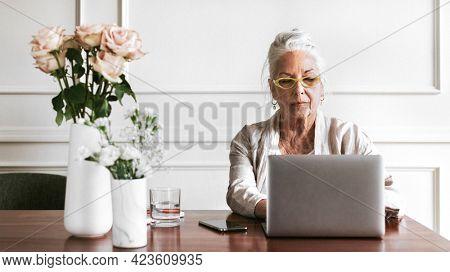 Empowering senior businesswoman using a laptop