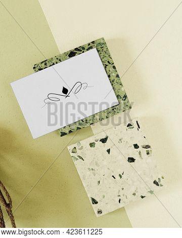 Design icon on white name card on granite cube mockup