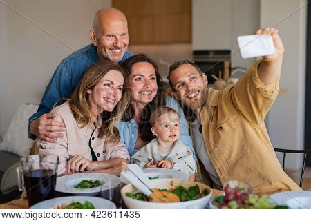 Happy Multigeneration Family Indoors At Home Eating Healthy Lunch, Taking Selfie.