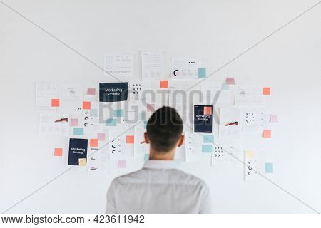 A casual business man looking at a marketing plan