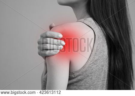 A Spasm On The Girl's Shoulder. Shoulder And Joint Injuries, And Fatigue At Work. The Zone Of Injury