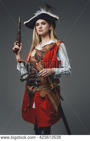 Woman Corsair With Two Handguns Against Gray Background