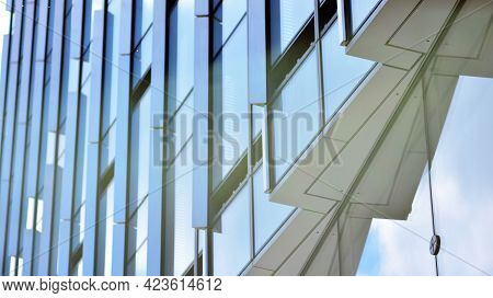 Glass And Aluminum Facade Of A Modern Office Building. View Of Futuristic Architecture. Office Build