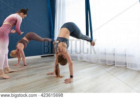 Conducting A Master Class On Aero Hammocks, An Air Yoga Trainer, Coaching Girls In Air Hammocks, Tea