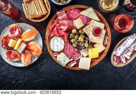Charcuterie And Cheese Platter, Overhead Flat Lay Shot On A Black Background With A Place For Text.
