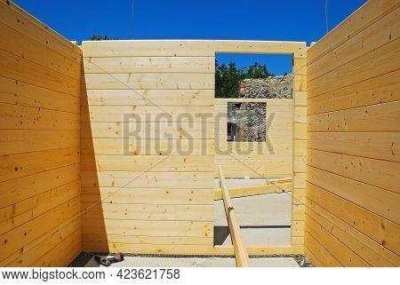 An Empty Door Frame Inside A Partially Constructed Wood (fir) Block House, A Pre-cut Wooden House Wh