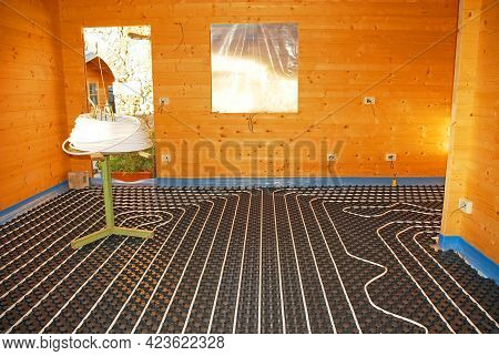 A Hydronic Closed Loop Underfloor Heating System Laid Out On A Molded Insulated Panel In Eps With A