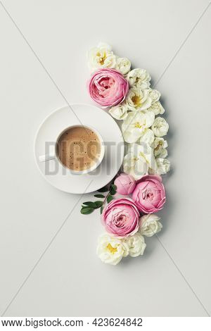 Cup Of Coffee And Beautiful Composition With Pink And White Rose Flowers. Top View And Flat Lay Styl