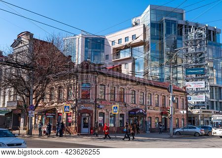 Saratov, Russia, March 14, 2019 - The Concept Of Contrast Between New And Old Architecture. An Old T