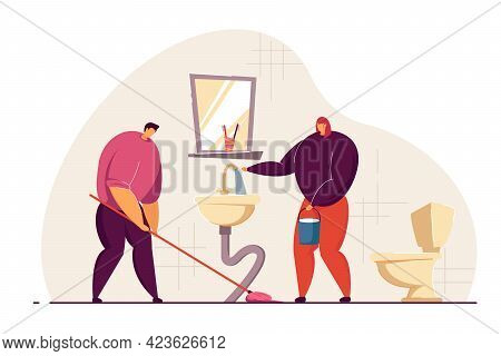 Married Couple Cleaning Bathroom Together. Wife Filing Bucket Up With Tap Water, Husband Mopping Flo