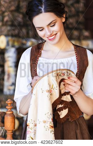 Lovely Caucasian Brunette Woman Posing With Fancywork Hoop In Retro Dress In Rural Environment.
