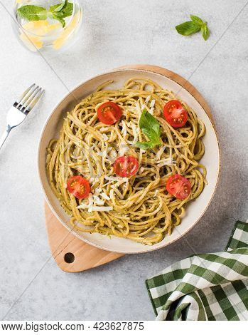 Spaghetti Pasta With Pesto Sauce And Cherry Tomatoes. Top View