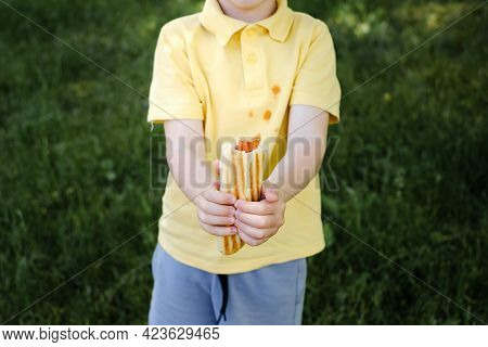 Ketchup Stains On A Yellow T-shirt. Daily Life Dirty Stain For Wash And Clean Concept. . High Qualit