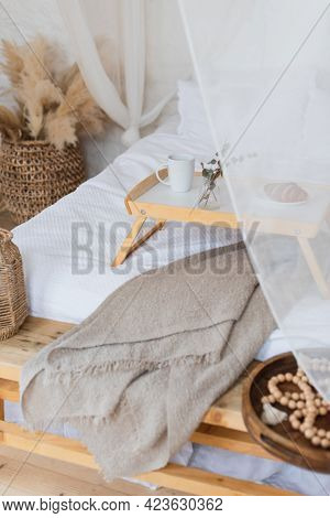 High Angle View Of Table With Breakfast On Bed With White Linen In Bohemian Style Bedroom