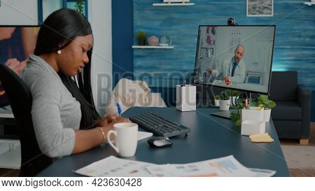 Sick Student Patient Discussing Sickness Symptoms With Physician Doctor During Online Videocall Tele