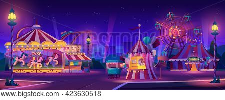 Amusement Park At Night. Festive Fair Entertainment Attractions. Carnival Circus Tent, Ferris Wheel,