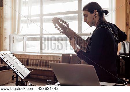 Male Artist Guitarist Working With Audio In Music Recording Studio