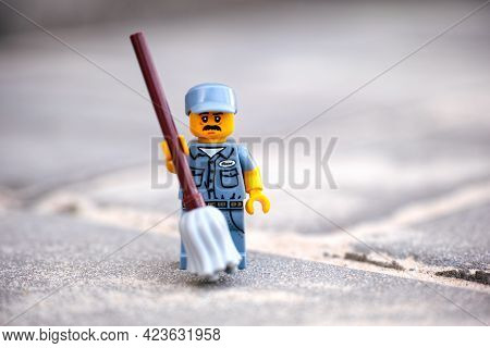Tambov, Russian Federation - May 26, 2021 A Lego Janitor Minifigure Holding A Mop Standing Outside
