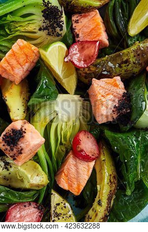 Salmon Salad Close-up, Appetizing Cubes Of Fried Salmon With Lettuce And Vegetables Top View