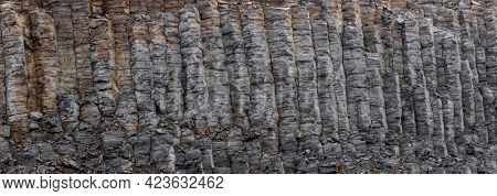 Panoramic view of tall basalt columns in Iceland