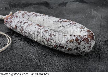 Dry Salami Sausage Fuet On Grey Textured Background.