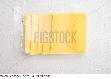 Pieces Of Cheddar Cheese Set, In Plastic Pack, On White Stone  Background, Top View Flat Lay