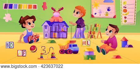 Boys And Girl Playing Toys At Kindergarten Or Daycare. Children With Doll House And Cubes For Develo