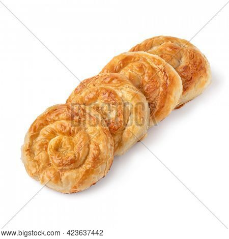 Row of traditional Turkish borek stuffed with cheese isolated on white background