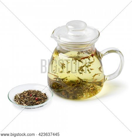 Glass teapot with a mixture of healthy herbal tea as a hot drink isolated on white background