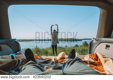Serene Beautiful View Of A Slender Young Woman Doing A Warm-up Against The Background Of Nature Lake