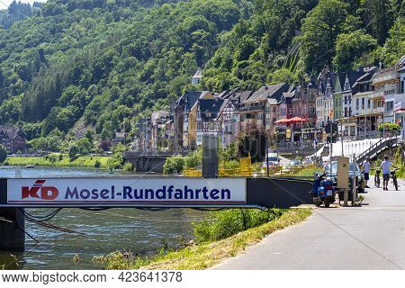 Cochem, Germany, June 13, 2021. Beautiful View Of The Colorful Buildings Along The River And The Old