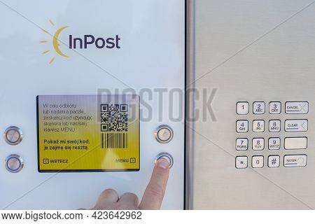 Poland, Poznan - Jun 09, 2021: Collecting A Package From The Mailbox - Inpost. Close-up Of The Parce