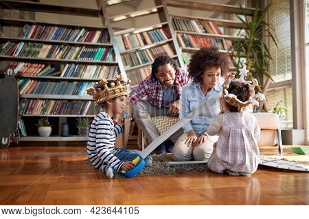 Young happy family has a wonderful time together in a relaxed atmosphere at home. Family, together, love, playtime