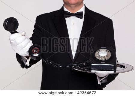 Butler handing you the receiver from a retro telephone upon a silver serving tray.