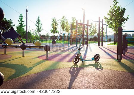 Scooter In The Park On The Playground. Active Lifestyle