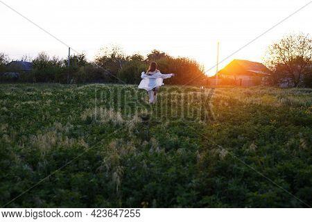 Girl In Underwear Running Across The Field
