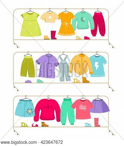 Clothes Racks. Wardrobe Stands With Kids Apparel. Isolated Simple Furniture Set For Storage And Show