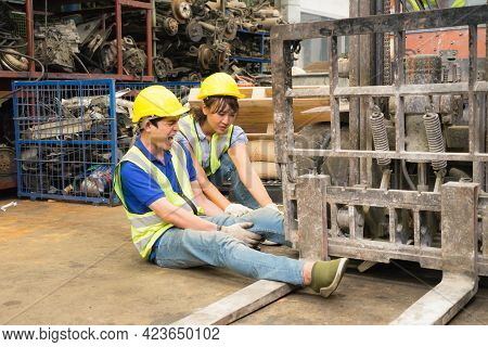 Accident Of Working Man In Wide Shot, Forklift Over Leg Of Engineer. Asian Engineer Worker Man Was C
