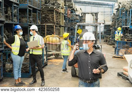 Men And Women Work Together, Wear Safety Facemask. Caucasian Engineer Man Using Walkie-talkie, Cauca