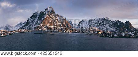 Amazing View To The Winter Reine Village At Pink Sunrise. Northern Norway, Lofoten Islands. Panorama