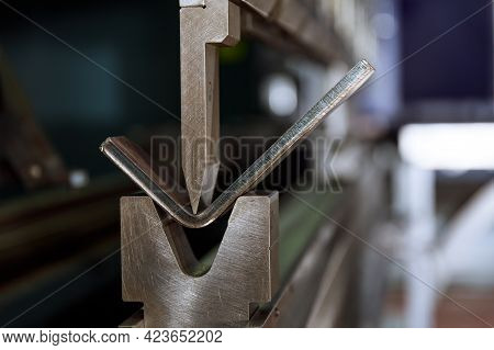 Metal Bending. Bending Of Metal Using A V-shaped Matrix And A Punch. The Process Of Bending Sheet Me
