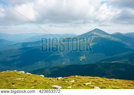 Carpathian Mountain Landscape In Summer. Hoverla Peak And Chornohora Ridge In The Distance. Cloudy A