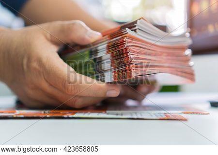 Business Brochure In Documents Concept : Businessman Hands Working In Stacks Brochures Paper Files F