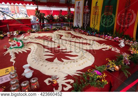 Puli Township, Taiwan - December 6th, 2020: offerings of food and fruits on the table during Taoist special dedication sacrificial ceremony in, Nantou, Taiwan