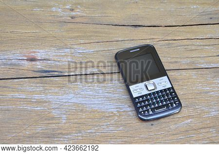 Telephone. Black Mobile Phone With Analog Tv, Radio, Stereo Speaker And Vintage Dual Chip Radio On A